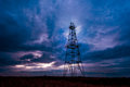 Abandoned oil rig, dramatic clouds and evening sky Stock Photo