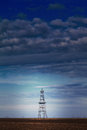 Abandoned oil rig profiled cloudy day sky active oilfield Stock Photos
