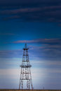Abandoned oil rig profiled cloudy day sky active oilfield Stock Images