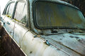 Abandoned old car classic in forest outdoor closeup shot Royalty Free Stock Photography