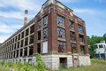 Abandoned old factory with broken windows