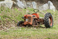 Abandoned old orange tractor countryside Stock Image