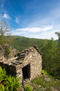 Abandoned old stones house with blue sky and forest in the background in the north of italy scareno close to verbania Stock Images