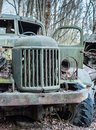 stock image of  Abandoned old-style military green track stays in forest in Chernobyl Exclusion Zone