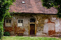 Abandoned old styled house with tile roofing Stock Photos