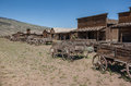Abandoned old west log buildings and wooden wagons in cody wyoming ghost town from the american wild cody is near yellowstone Royalty Free Stock Photos