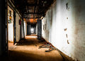 Abandoned old workplace corridor with open doors Royalty Free Stock Photo