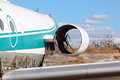 Abandoned passenger airplane broken vandalised and stolen engine closeup Stock Photo
