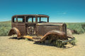 Abandoned Rusted antique car near painted desert on Route 66 Royalty Free Stock Photo