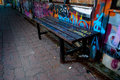 Abandoned seat at the bus stop painted with grafitti Royalty Free Stock Photos
