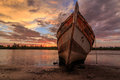 Abandoned ship the during golden hour sunset momment Royalty Free Stock Image