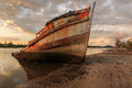 Abandoned ship the during golden hour sunset momment Royalty Free Stock Photos