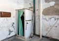 Abandoned shower and man inside Trans-Allegheny Lunatic Asylum Royalty Free Stock Photo