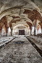 The abandoned stables destroyed with brick vault with an pillars Stock Image