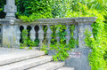Abandoned staircase ancient architecture overgrown with plants Stock Photo