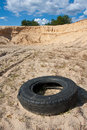 Abandoned tire on sandy Royalty Free Stock Photos