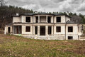 Abandoned unfinished big modern house in suburban area Royalty Free Stock Photography