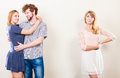 Abandoned woman with enamored couple jealousy and betrayal concept unloved girl watching on happy hugging triangle relationship Royalty Free Stock Photos