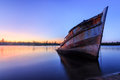 Abandoned wooden ship the during blue hour sunset momment Stock Photography