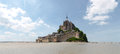 Abbey of mont st michel france june view the from the sands at low tide there are some unknown persons Royalty Free Stock Photo