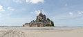 Abbey of mont st michel france june view the from the sands at low tide there are some unknown persons Stock Photos