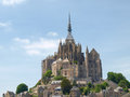 Abbey of mont st michel france june view the from the sands at low tide there are some unknown persons Stock Image