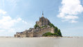 Abbey of mont st michel france june view the from the sands at low tide there are some unknown persons Royalty Free Stock Photography