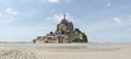 Abbey of mont st michel france june view the from the sands at low tide there are some unknown persons Stock Photo