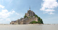 Abbey of mont st michel france june view the from the sands at low tide there are some unknown persons Stock Images