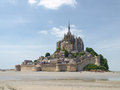 Abbey of mont st michel france june view the from the sands at low tide there are some unknown persons Royalty Free Stock Photos