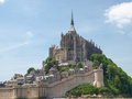 Abbey of mont st michel france june view the from the sands at low tide there are some unknown persons Royalty Free Stock Image
