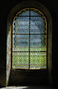 Abbey window simple patterned stained glass in a french Royalty Free Stock Photo