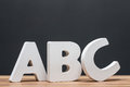 Abc alphabet letters in front of blackboard Royalty Free Stock Photo