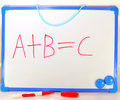 Abc the first three letters of the alphabet a b and c written on a white board in red ink symbolic of learning or education Royalty Free Stock Photo
