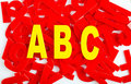 Abc letter closeup find in yellow letters on a background of red in a jumble or word search puzzle Royalty Free Stock Photography