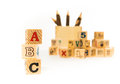 Abc wood block alphabet on white background with pencils box Stock Images