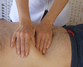 Abdominal examination female therapist performing on male torso Stock Images