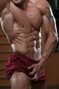 Abdominal muscle close up portrait of a physically fit muscular young man Stock Images