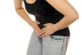 Abdominal pain young slim female has Stock Photos