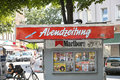 Abendzeitung sign on a kiosk in munich a crow is picking on it which is symbolizing the problems the newspaper has Stock Images