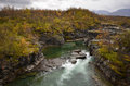 Abisko canyon a picturesque view of the in sweden during autumn season Stock Photos