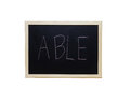 ABLE written with white chalk on blackboard Royalty Free Stock Photo