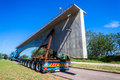 Abnormal truck trailer bridge section load of fifty ton new concrete being moved onto umgeni durban south africa Stock Images