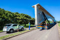 Abnormal truck trailer bridge section load of fifty ton new concrete being moved onto umgeni durban south africa Stock Photos