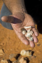Aboriginal artefacts a mans hand is shown presenting autralian stone Royalty Free Stock Photos