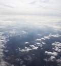 Above the clouds photo of puffy and blue sky from Royalty Free Stock Photography
