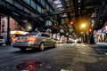 Above ground subway line and New York City street in Brooklyn with cars Royalty Free Stock Photo