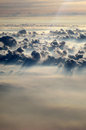 Above Henvenly Clouds with Sun Casting Light Royalty Free Stock Photo