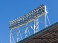 Above roof stadium lighting electrical array of high power components Royalty Free Stock Photo