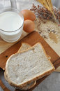 Above Shot of Whole Grain Bread with Milk and Eggs on Background